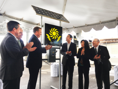 L to R: Allan Schurr, president of Edison Energy; Doug Drummond, commissioner of the Port of Long Beach; Anthony Otto, president of Long Beach Container Terminal; Long Beach Mayor Robert Garcia; Gina Heng, vice president and general manager of Mitsubishi Electric Photovoltaic Division; and James Hankla, senior vice president of governmental relations at PFMG Solar, watch the ceremonial flip of the switch to power on the new 904.75kW solar array at Long Beach