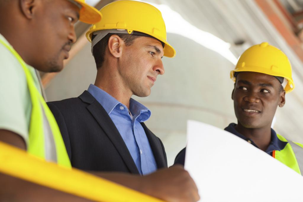 industrial manager and workers working on planning